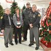WARREN DILLAWAY / Star Beacon<br /> BILL SCHLEGEL, president of the ATV Traction club, (second from right) presented Fraternal Order of Police Lodge 106 representatives with a $1,400 check for the lodge's Shop with a Cop program on Dec. 14 at Super Kmart in Ashtabula Township. (From left) Julius Petro, lodge secretary-treasurer; Amy Burns,  store manager, Schlegel and Rick Schupska, lodge vice-president.