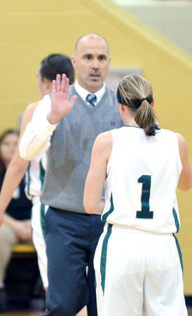 WARREN DILLAWAY / Star Beacon<br /> DAVE MALLONE, Lakeside girls basketball coach, congratulates Kristin Keasling on Tuesday evening during a home game with Cardinal Mooney.