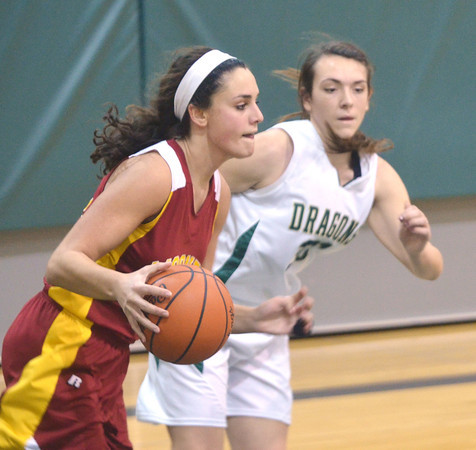 WARREN DILLAWAY / Star Beacon<br /> ALEXIS BENEDICT (right) of Lakeside defends Jaclyn Yankle of Cardinal Mooney on Tuesday night at Lakeside.