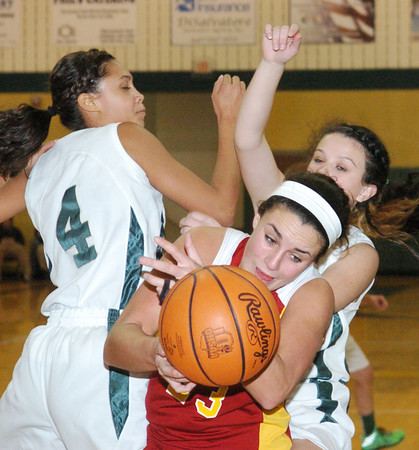 WARREN DILLAWAY / Star Beacon<br /> JACLYN YANKLE (23) of Cardinal Mooney reaches for the ball between Lakeside defenders Sharisse Hunt (4) and Nikki Kelly (right back) on Tuesday night at Lakside.