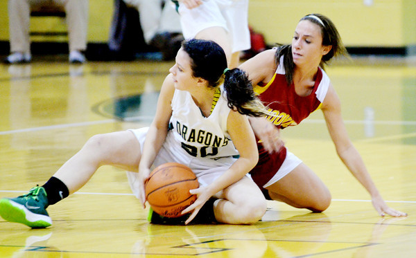 WARREN DILLAWAY / Star Beacon<br /> NIKKI KELLY (20) of Lakeside and Jamie Domenico of Cardinal Mooney fight for the ball on Tuesday night at Lakeside.