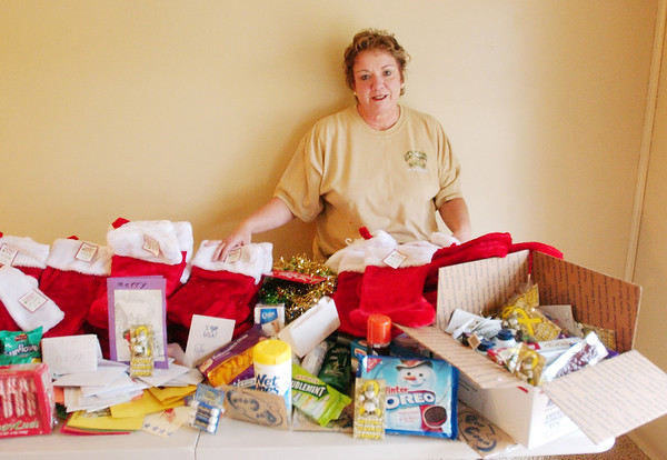 WARREN DILLAWAY / Star Beacon<br /> SHARON BRADLEY of Saybrook Township displays items donated to send to a military unit in Afghanistan.