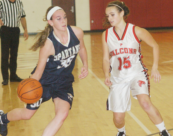 WARREN DILLAWAY / Star Beacon<br /> SHAE BRINK (35) of Conneaut drives to the basket with Jefferson's Colleen O'Connor defending Tuesday night at Jefferson.