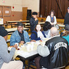 WARREN DILLAWAY / Star Beacon<br /> VISITORS TO G.O. Ministries Thanksgiving Day dinner eat and chat on Thursday morning in Ashtabula.