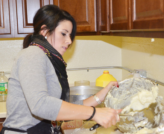 WARREN DILLAWAY / Star Beacon<br /> ANGELA PRISTERA, a volunteer at Lighthouse Harvest Foundation, prepares Thanksgiving dinner at the old armory building on State Road in Ashtabula Township.