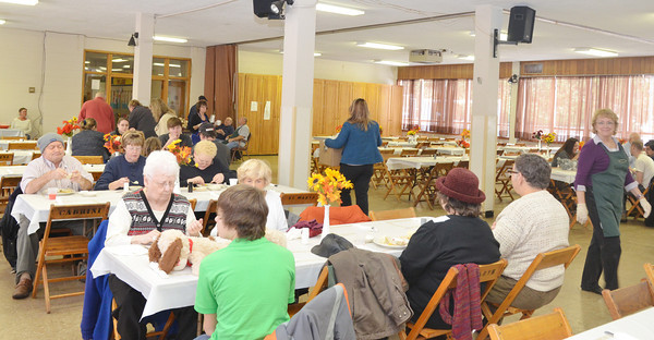WARREN DILLAWAY / Star Beacon<br /> MORE THAN 300 people were served Thanksgiving Dinner at Corpus Christi Parish in Conneaut on Thursday.