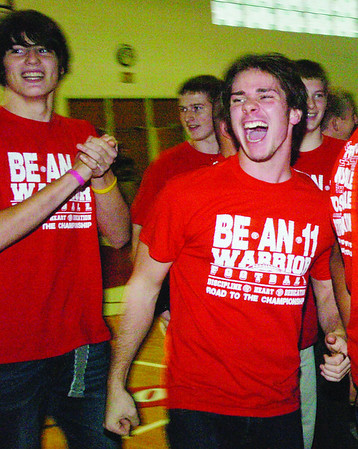 WARREN DILLAWAY / Star Beacon<br /> ANTHONY COLBY (right) and his Edgewood football teammates celebrate after finding out they were in fact heading for the Ohio High School Athletic Association football playoffs after a court decision finalized their entry Friday afternoon.