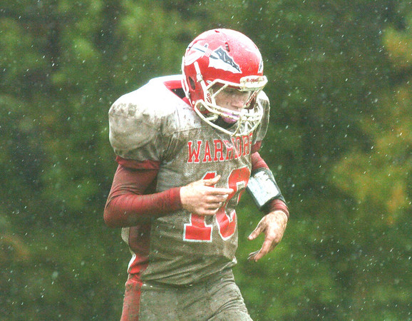 WARREN DILLAWAY / Star Beacon<br /> ALEX STUGILL of Edgewood is covered with mud on Saturday during a game with Lutheran East at Cleveland Heights.