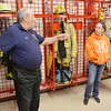 WARREN DILLAWAY / Star Beacon<br /> TONY LONG, fiscal officer for the village of Madison and the Madison Fire District, (left) talks with Mary Conoway and her son Matt Conoway during a tour of the new fire station and headquarters on Route 528 just south of Interstate 90.