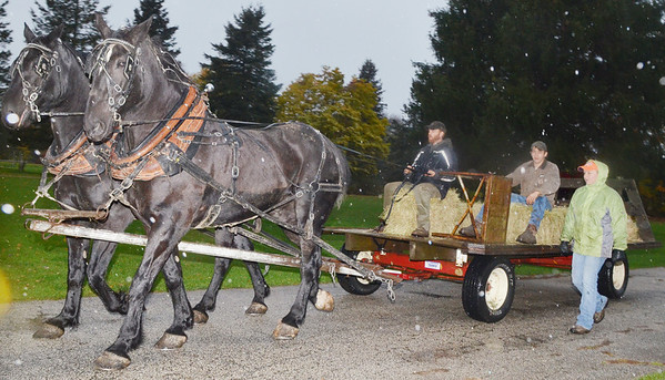 WARREN DILLAWAY / Star Beacon<br /> A FEW brave people took advantage of a horse drawn hay ride at the North Kingsville Village Hall during Trunk or Treat events on Thursday evening.