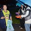 JOSE MCCAIN works on his candy collection skills while trick or treating in Ashtabula Township Thursday evening.
