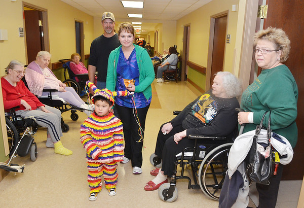 WARREN DILLAWAY / Star Beacon<br /> JOSEPH AUSTIN, 4, of Plymouth Township, enjoys an evening of trick or treating at Austinburg Nursing and Rehab Center.