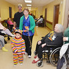 WARREN DILLAWAY / Star Beacon<br /> JOSEPH AUSTIN, 4, of Plymouth Township, enjoys an evening of trick or treating at Austinburg Nursing and Rehab Center.