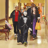 WARREN DILLAWAY / Star Beacon<br /> MICHAEL MCELHINNY (front) and Kayleen Kennedy, 12, (right middle) enjoy an evening of trick or treating at Austinburg Nursing and Rehab Center.