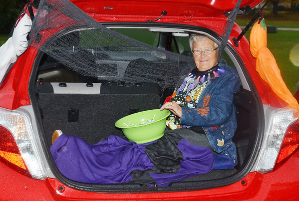 WARREN DILLAWAY / Star Beacon<br /> ELLEN MCCONNELL PAGE stays dry during a rainy evening of trunk or treating at the North Kingsville Village Hall.