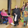 WARREN DILLAWAY / Star Beacon<br /> GRACE NAPPI (left) watches Matthew  (center), 9,  and Noah, 7, Watts during a trick or treat night at Austinburg Nursing and Rehab Center.