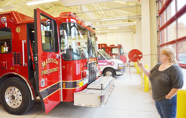 WARREN DILLAWAY / Star Beacon<br /> MARY ANN FROEBE of Madison Township takes pictures with her cell phone on Saturday during a tour of the new fire station on Route 528 just south of Interstate 90 in Madison Township.
