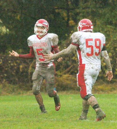 WARREN DILLAWAY / Star Beacon<br /> RIIS SMITH (5) celebrates with Edgewood teammate Austin Sturgill after Smith scored a touchdown on Saturday at Lutheran East in Cleveland Heights.