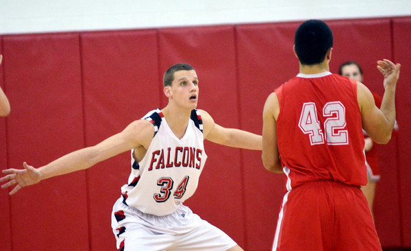WARREN DILLAWAY / Star Beacon<br /> DAVID CHASE (34) of Jefferson defends Ron Varckette of Geneva on Friday night at Jefferson.