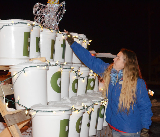 WARREN DILLAWAY / Star Beacon<br /> TRACY DERYLAK of Living Water Baptist Church puts the finishing touches on a float Friday evening prior to the Conneaut Christmas Parade.
