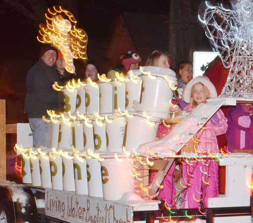 WARREN DILLAWAY / Star Beacon<br /> A TIME exposure photograph creates the appearance of moving lights on the Living Water Baptist Church float on Friday evening during the Conneaut Christmas parade....