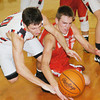 WARREN DILLAWAY / Star Beacon<br /> SAGE CANTINI (left) of Jefferson and Jeramiah Allen of Geneva battle for a loose ball on Friday night at Jefferson.