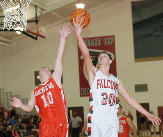 WARREN DILLAWAY / Star Beacon<br /> LUCAS HITCHCOCK (30) of Jefferson drives to the hoop as Brandon Kovach of Geneva defends on Friday night at Jefferson.
