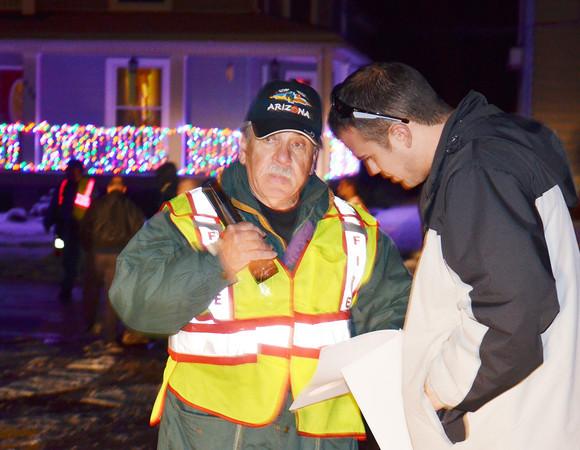 WARREN DILLAWAY / Star Beacon<br /> JIM JONES (left) helps David Schreiber find his spot in the Conneaut Christmas Parade on Friday evening.