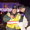 WARREN DILLAWAY / Star Beacon<br /> JIM JONES (left) helps David Schreiber find his spot in the Conneaut Christmas Parade on Friday evening.