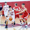 WARREN DILLAWAY / Star Beacon<br /> LUCAS HITCHCOCK of Jefferson (30) dribbles up court with  Steve Jewell (right) of Geneva on Friday night at Jefferson.