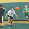 WARREN DILLAWAY / Star Beacon<br /> JOSE RAMOS (right) prepares to catch a pass from Isaiah Mathers (far left) as Tristan Bradley defends on Monday evening at Lakeside basketball practice.