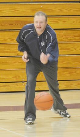 WARREN DILLAWAY / Star Beacon<br /> TIM TALLBACKA, Conneaut boys basketball coach, rolls a ball to start a drill during a Monday afternoon practice.