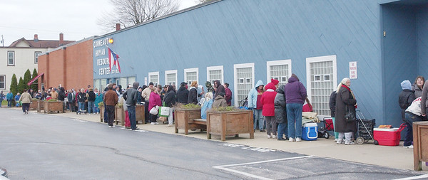 WARREN DILLAWAY / Star Beacon<br /> DOZENS OF people wait outside the Conneaut Human Resources Center to receive free produce.