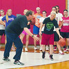 WARREN DILLAWAY / Star Beacon<br /> EDGEWOOD GIRLS basketball coach Dave McCoy and <br /> April Lane (with ball) demonstrate a drill Monday during basketball practice.