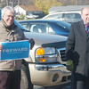 WARREN DILLAWAY / Star Beacon<br /> CHUCK HERRING of Austin, TX. and a representative of the Obama Campaign, (left)  and Ron Graham, who was campaigning for his Republican brother Steve in the county commissioner race, shared parking lot space Tuesday outside Mount Carmel Community Center where voting took place.