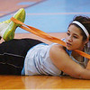 WARREN DILLAWAY / Star Beacon<br /> RAE ANN BENEDICT stretches before girls basketball practice Thursday at Mahoney Gymnasium in Ashtabula.