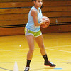 WARREN DILLAWAY / Star Beacon<br /> ALICIA NGIRAINGAS works on her pivot during ball handling drills at St. John High School girls basketball practice Thursday.