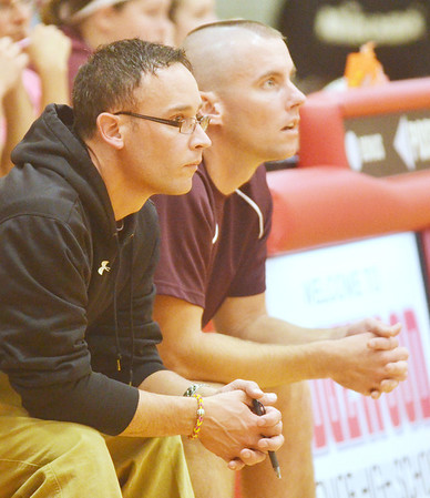 WARREN DILLAWAY / Star Beacon<br /> ROB WLUDYGA (left), Pymatuning volleyball coach, and his assistant Randy Reubel watch the action on Tuesday at Edgewood.