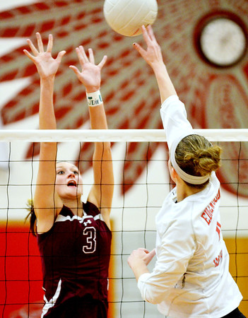 WARREN DILLAWAY / Star Beacon<br /> KELSEA BROWN (3) of Pymatuning  Valley leaps for a block of a spike by Alyssa Johnson of Edgewood   on Mondayevening in Ashtabula Township.