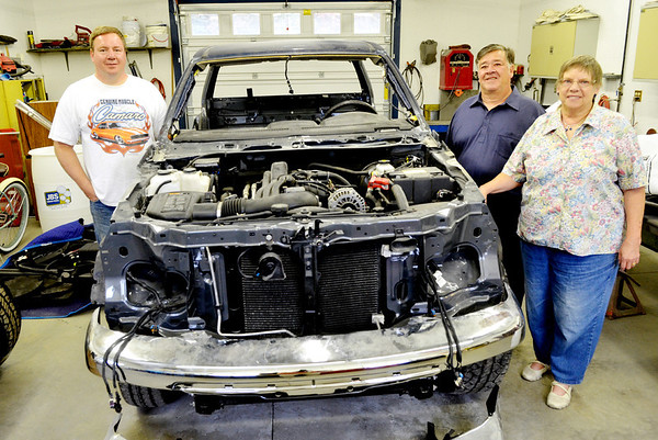 WARREN DILLAWAY / Star Beacon<br /> RAY BROCKETT (left) displays a truck he is rebuilding at his Pierpont Township. Brockett went to Pierce, Neb.,  this weekend for an auction of almost 500 cars with relatives Roger and Gail Brockett, also of Pierpont Township.
