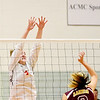 WARREN DILLAWAY / Star Beacon<br /> ALYSSA JOHNSON (facing) of Edgewood leaps for a block of a spike by Kelsea Brown of Pymatuning Valley on Monday at Edgewood.