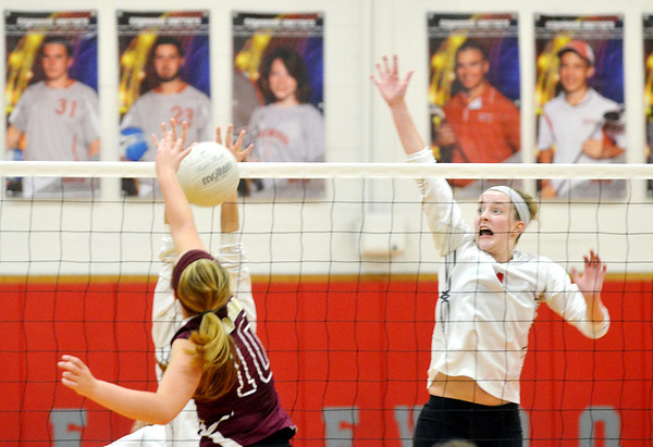 WARREN DILLAWAY / Star Beacon<br /> ALYSSA JOHNSON (right) of Edgewood leaps for a block as Angela Lipani (10) of Pymatuning Valley spikes the ball on Monday during a match at Edgewood.