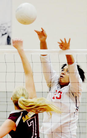 WARREN DILLAWAY / Star Beacon<br /> IESHA NICIU of Edgewood spikes the ball over the net  and Megan Stech (7) of Pymatuning Valley during a match at Edgewood on  Monday.