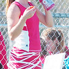 WARREN DILLAWAY / Star Beacon<br /> ALYX LYNHAM of Geneva takes a break during a first singles match Tuesday at Lakeside.