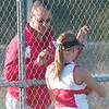 WARREN DILLAWAY / Star Beacon<br /> SCOTT TOROK, Geneva tennis coach, talks with first singles player Alyx Lynham Tuesday during a match at Lakeside.