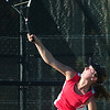 WARREN DILLAWAY / Star Beacon<br /> ALYX LYNHAM of Geneva serves during a first singles match Tuesday at Lakeside.