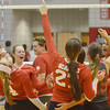 WARREN DILLAWAY / Star Beacon<br /> MEMBERS OF the Geneva volleyball team celebrate with coach Annah Haesler (third from left behind) after clinching a PAC title with a home win over Eastlake North on Thursday night.