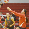 WARREN DILLAWAY / Star Beacon<br /> CHELSEA  SCAFURO (right) sets the ball as Geneva teammate Christa Cash (15) looks on Thursday night during a home match with Eastlake North.