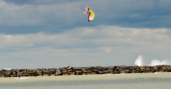 WARREN DILLAWAY / Star Beacon<br /> A WINDSURFER takes advantage of brisk winds as waves pound the Conneaut breakwall on Monday afternoon.