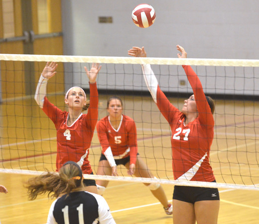 WARREN DILLAWAY / Star Beacon<br /> MEGAN COOL (4) and Chelsea Scafuro (27), both of Geneva, reach for the ball as fellow Eagle Kylee Corlew (5) watches the ball after a spike by Jackie Butera of Eastlake North on Thursday night at Geneva.